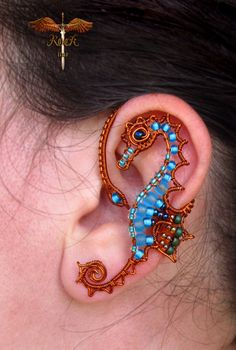 Custom seahorse ear cuff ear wrap by RockTime on Etsy, $30.00 I absolutely ADORE seahorses!!! This