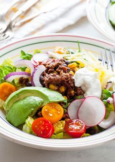 Taco Salad made with healthy ground turkey, black beans, and corn. Serve warm or cold over romaine lettuce with fresh tomatoes, avocados, and shredded cheese. Perfect for a mid-week meal or make-ahead lunch.