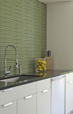 Add a little midcentury style to your space. Backsplash Tile: Island Stone Glass Waveline Seagrass Backsplash Tile, Tiles, Tile Manufacturers, Unique Colors, Shades Of Green, Your Space, Your Design, Kitchen Cabinets, Island