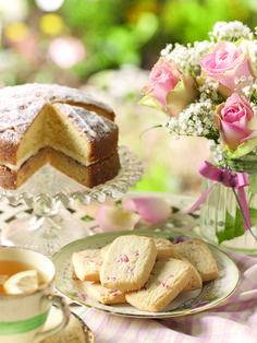 rose petal & almond biscuits and a classic victoria sponge cake served with tea