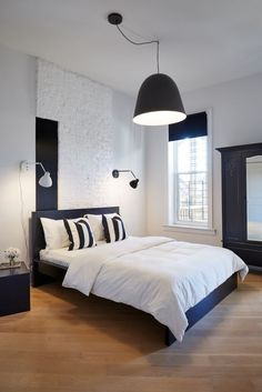 Black and white apartment with contemporary design, blonde floors, gallery style walls and vintage touches. Black And White Pendants, White Pendant Light, Black Canopy Beds, Pendant Lighting Bedroom, Interior Styling, Interior Design, White Apartment, White Home Decor, White Houses