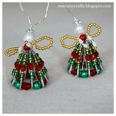 Safety pins and beautiful red and green beads come together to bring these Sweet Safety Pin Angels to life. Because they're made from an often-overlooked household item, these budget-friendly DIY angel ornaments are a sight to behold. Christmas Angel Crafts, Easy Christmas Ornaments, Christmas Angels, Christmas Projects, Holiday Crafts, July Crafts, Homemade Christmas, Diy Christmas, Christmas Decorations