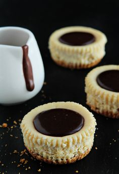 Chocolate chip cookie dough baked inside mini cheesecakes and topped with a pool chocolate ganache.