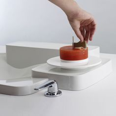 Swiss soap - Soap dispenser prototype by Max Neustadt for Axor Bouroullec. Soap dispenser based on the traditional swiss tool for cutting 'Tête du Moine' cheese. The process makes a curl of soap just perfect for a single use. Created for the Axor Bouroullec bathroom collection. #designwithheart