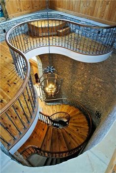 A spiral staircase in the 17+ million dollar house for sale at 1358 Page Road, Nashville TN.
