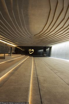 A stepped concrete ceiling, 6 meters wide, adds a touch of drama to the minimalist prayer hall.  Sancaklar Mosque, Istanbul.  Photo by Bünyamin Salman, via Flickr.
