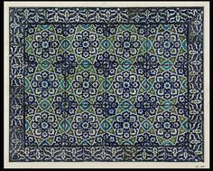Tile panel | Made in Damascus, Syria, 16th century-17th century | Materials: fritware with polychrome underglaze painting | Panel of twenty-nine tiles of glazed fritware, painted in shades of cobalt blue, sage-green and manganese on a white slip, with conventional floral devices in interlacing geometrical compartments outlined in white. Seventeen tiles form a border and are decorated with arabesque ornament in white and light blue on a dark ground | VA Museum, London