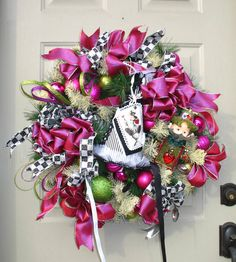 Alice in Wonderland Mad Hatter Wreath. Have to make one like this for Cami's party but in Red/Pink