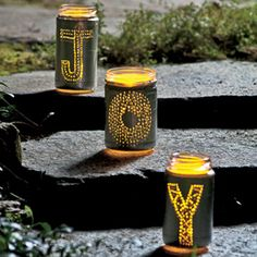 Luminaries made from recycled jars.  I'm thinking fill them with citronella candles and put them on the deck.