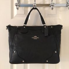 Coach A1532 Black Silver Leather Tote Bag Silver hardware.  Zip closure.  3 interior pockets.  Double hang tag.  Front magnetic pocket.  Measures: 12x5.25x10x4.75. Leather.  Great condition. Coach Bags Totes