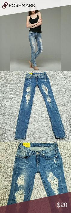 Machine nouvelle mode distress  bling jeans In good condition upper thigh distress look with bling buttons  Measurements laying flat  Waist 13 inches Hips 15 inches  Rise 7 inches  Inseam 31 inches  Jeans have some stretch to them machine nouvelle mode  Jeans Skinny