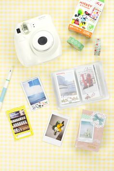 How adorable is the Handy Instax Mini Box? It can hold up to 12 photos, business cards, credit cards, or any important papers you might have. With a waterproof surface and elastic band attached, your