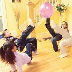 Balloon volley ball, make 2 teams put a piece of tape or yard across the floor, kids can only use there feet! Great excercise for rainy or cold winters day!