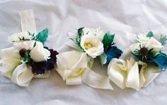 We can plan on these for the corsages.  Do you want them all ivory with a touch of your accent color?