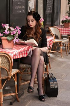 """Reading at table in sidewalk café, Paris. """"He who contemplates the depths of Paris is seized with vertigo. Nothing is more fantastic. Nothing is more tragic. Portrait Girl, Poses, Idda Van Munster, Parisienne Chic, Woman Reading, Girl Reading Book, Clothes Horse, Belle Photo, Black And White Photography"""