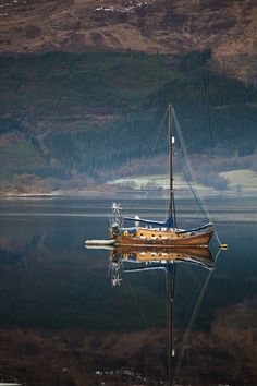 wasbella102:  Peaceful Reflection - Sail Boat on a Scotish Loch in the calm clear air of winter by Stage Shoot