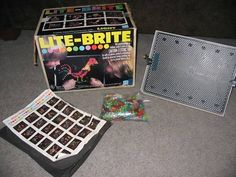 Lite Brite - two things come to mind about this awesome 70s toy...the smell of all that plastic heating up in combination with the blackout paper's scent, and the fact that I must have lost a hundred of those plastic pieces in our green shag carpet...LOST lost them, as in even the vacuum never found them.