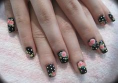 Pink flowers on black-and-white polkadot background