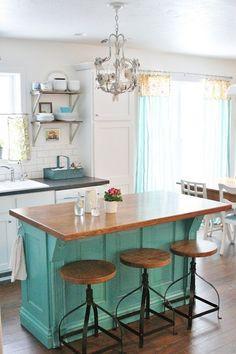 turquoise kitchen island with metal barstools