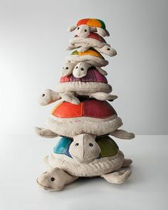 Renate Muller Therapeutic Toy Seals in nauural jute with colored leather detailing.