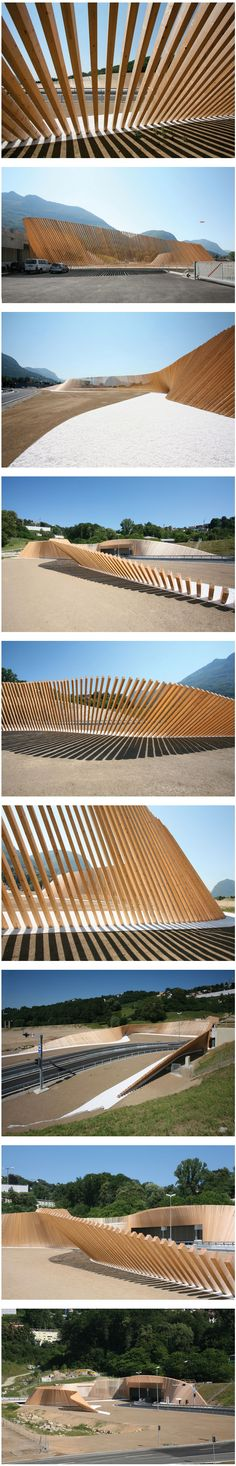 A large sinuous screen of wood designed by italian practice Cino Zucchi Architects defines a playful visual space at the entrance of the Vedeggio-Cassarate tunnel. Pinned to Garden Design - Walls, Fences and Screens by Darin Bradbury.