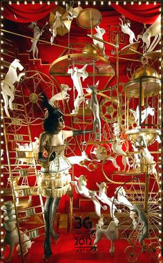Bergdorf Goodman had a Holiday window display with dog mannequins doing acrobatics.   We have dog mannequins for sale at MannequinMadness.com for window displays like this.