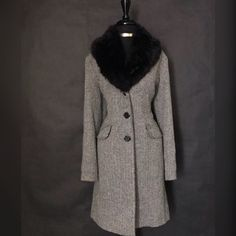 "George Ladies Coat - Size 8/10    This is a gorgeous George Brand Ladies winter coat. It has three buttons in front, long sleeves and a beautiful faux fur collar for both style and warmth, and is black and gray in appearance. The shell is made from 40% wool and 60% polyester. The Lining is made of 100% polyester.     The Jacket is a size 8/10 with the following measurements:  Length: 42""  Bust: 45""  Waist: 39""    This item ships immediately to US addresses. 📦 Also available for local try on…"
