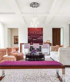 2: A Modern White Living Room in Dallas, TX  Interior designer Deborah Walker used linens and velvets by Donghia and Chivasso to introduce this Dallas home's aubergine and persimmon scheme in the living room.