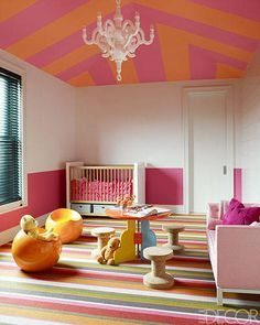 Get creative with one pattern, as seen here with thin stripes on the rug and angled stripes on the ceiling.