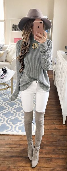 White Skinny Jeans, Grey Long Sleeved Jumper, Grey Hat And Grey Knee High Heels.                                                                                                                                                                                 More