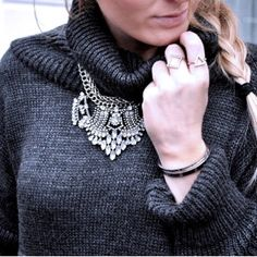 Comfi Cozy grey knitted sweater with statement necklace. Shop at www.bidyouroutfit.com