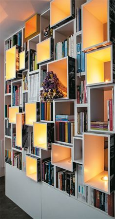 love the subtle lighting of this beautiful bookcase...