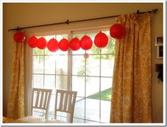 Super easy balloon garland...for night parties just snap a glow stick & drop it in before blowing up the balloon.