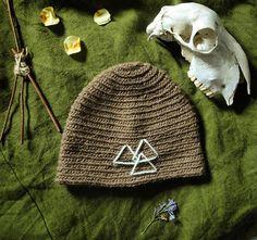 Valknut on brown woolen hat, nalbinding by Crone Yhrm Crafts. www.etsy.com/shop/CroneYhrmCrafts