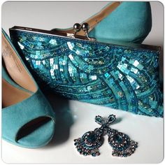 """NWT TEAL SEQUIN EVENING BAG Beautiful teal sequin & satiny back evening bag with beading & SHW with large kiss clasp top closure. The bag has 3 option carry as a clutch, hand bag with clear beaded strap & silver chain strap for shoulder option. The bag does have a flaw on the back. It is not a rip or torn threads. The bag was purchased for a Get Real in Teal ovarian cancer awareness fashion campaign. The bag is beautiful despite the small flaw. Measures 10""""x4"""". Tag is still attached.  Price…"""
