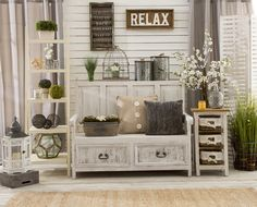 Love Joanna Gaines Fixer Upper style? Get the look yourself using rustic wood wall art, terrariums, lanterns, pillows, and of course greenery. Click to shop the look.