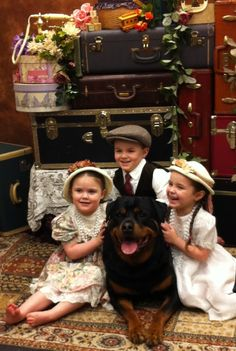 nevermind the kids.  lookit how cute the rottweiler is?