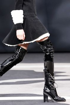 Chanels thigh-high boots.
