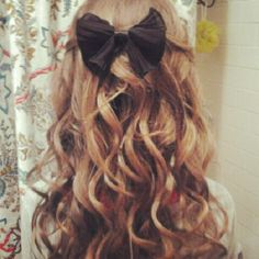 curled hair with black bow