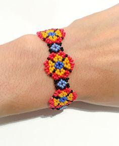 Items similar to Mexican Huichol beaded bracelet on Etsy Beaded Cuff Bracelet, Lace Earrings, Seed Bead Bracelets, Beaded Flowers Patterns, Beaded Jewelry Patterns, Beading Patterns, Handmade Beaded Jewelry, Handcrafted Jewelry, Bead Crafts
