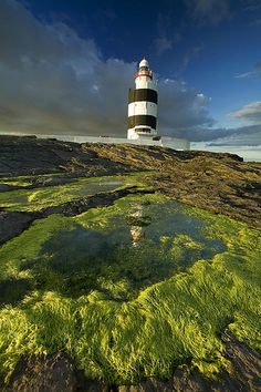 "Ireland. Hook Head lighthouse, in Co. Wexford. "" by Hook or by Crook""  some say that phrase  was coined here by Oliver Cromwell . His vow was to take Waterford by hook, the town, or by Crook a village nearby."