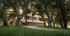 A native oak woodland in the Santa Lucia Preserve embraces a new home by Sagan Piechota Architecture. Concealed in the woods, yet with clear distant views to the hills beyond, this flipped plan home puts the main living in the trees on the eastern exposure. Outdoor spaces engage the hillside to the West, and portals for landscape viewing to the North and South. The west court is an artful composition of stone and water, with the native meadow on the hillside as a visual backdrop and dynamic…
