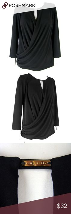 "New  Ann Klein Black Stretch Jersey Draped Top L Ann Klein top in black stretch jersey. Cross-over draped bodice with ruching at the right hip, a tiny band with logo plaque at the neck keeping the drape in place, and three-quarter sleeves. The back hangs straight. New with tag, retail $69.00   Care - Machine wash.      Shoulder - 16""     Bust - 42""     Hem - 40""     Length - 25"" (top of shoulder seam down back to hem)     Sleeve - 20"" Anne Klein Tops Tunics"