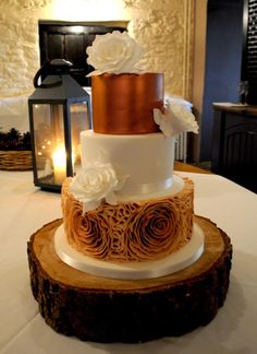 Copper and white wedding cake with ombre copper ruffles and sugar roses