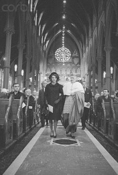 Mrs. Kennedy Being Escorted  Mrs. Jacqueline Kennedy is escorted to seat by Richard Cardinal Cushing who celebrated Solemn Pontifical Mass of Requiem for the late President at the Holy Cross Cathedral.  Date Photographed:January 19, 1964.❤❤❤❤  http://en.wikipedia.org/wiki/Jacqueline_Kennedy_Onassis
