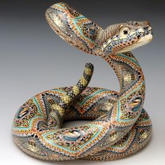 Artist Jon Anderson's polymer clay Mama Rattle Snake Sculpture is a celebration of unique artistic perspective and craftsmanship. Handmade and no two pieces are alike.