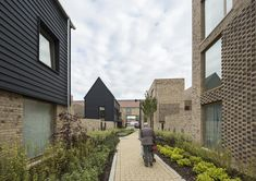 Chequered brickwork brings unity to a Cambridge housing community by Proctor and Matthews (Dezeen) Social Housing Architecture, Brick Architecture, Architecture Collage, Residential Architecture, Commercial Architecture, Arch House, Brick Facade, Brickwork, House Design