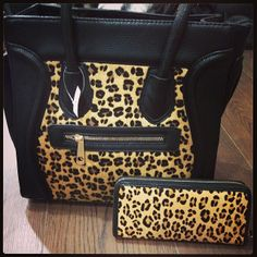 Black and leopard print purse with matching wallet.