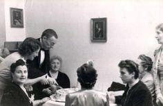 Sergei Rachmaninoff cutting his birthday cake.