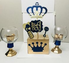 NEW 2018 ROYAL PRINCE BABY SHOWER TWO ROYAL PRINCE BABY SHOWER CENTERPIECES - ROYAL BLUE & GOLD This listing is for only 2 (Two) Royal Prince Baby Shoes and Stroller Centerpiece in Royal Blue and Gold. Approx. 10 inches in size decorated to your baby shower theme. - Baby